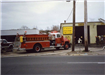 Red Fire Truck in Front of Muffler Business