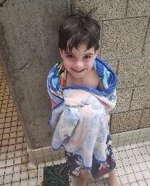 This is an image of a child after swim lessons.
