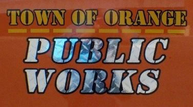 Image of Public Works and logo on truck doors