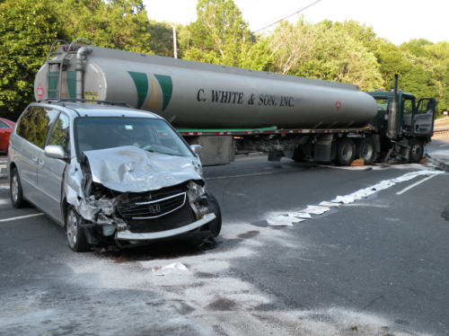 crashed car next to semi truck