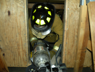 firefighter holding silver cylinder