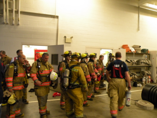 several firefighters standing