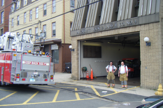 firefighters standing in front of entrance