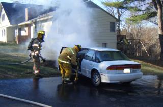 firefighter looking into smoking car