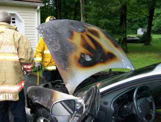 damaged hood of car